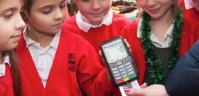 Chip and PIN terminal with child carol singers