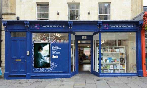 A Cancer Research UK shop with a contactless giving window