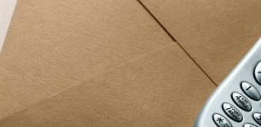 Envelopes and mobile phone - OlgaLis on Shutterstock.com
