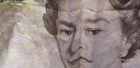 Queen Elizabeth II looking sad on £5 bank note - image achieved with folding the banknote